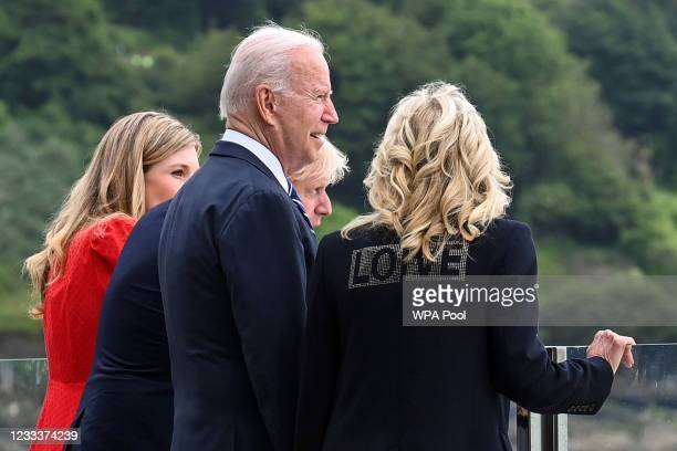 Britain's Prime Minister Boris Johnson and his wife Carrie Johnson stand together with U.S. President Joe Biden and First Lady Jill Bidenn as they...