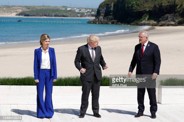 Britain's Prime Minister Boris Johnson and his wife Carrie Johnson greet Australia's Prime Minister Scott Morrison at the G7 summit in Carbis Bay on...