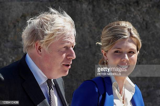 Britain's Prime Minister Boris Johnson and his wife Carrie Johnson arrive for the official welcome during the G7 summit in Carbis Bay, Cornwall on...