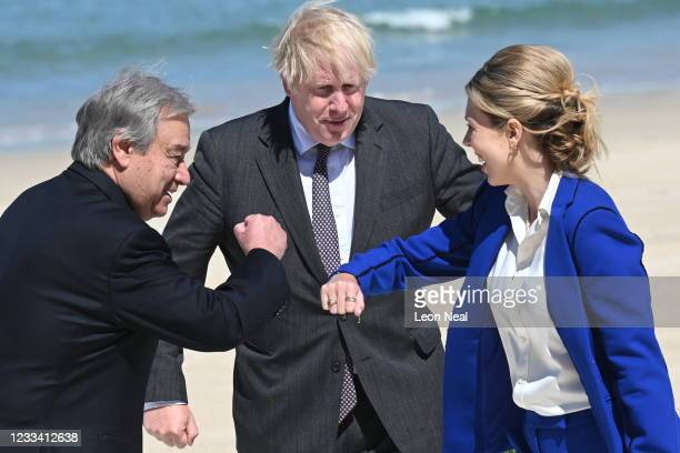 Britain's Prime Minister Boris Johnson and his wife Carrie Johnson greet United Nations Secretary General Antonio Guterres at an official welcome at...
