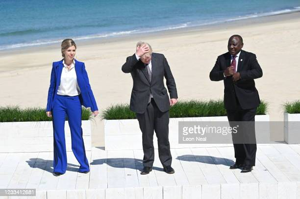 Britain's Prime Minister Boris Johnson and his wife Carrie Johnson stand with South Africa's President Cyril Ramaphosa at the G7 summit in Carbis Bay...
