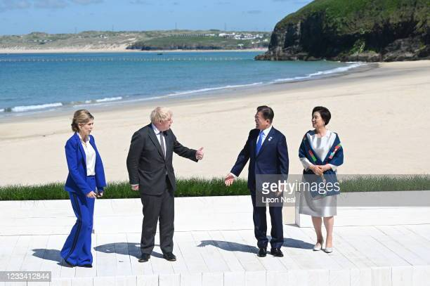 Britain's Prime Minister Boris Johnson and his wife Carrie Johnson pose with South Korea's President Moon Jae-in and wife Kim Jung-sook at the G7...