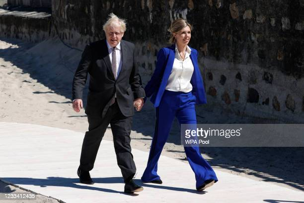 Britain's Prime Minister Boris Johnson and his wife Carrie Johnson arrive to welcome leaders during the G7 summit in Carbis Bay on June 12, 2021 in...
