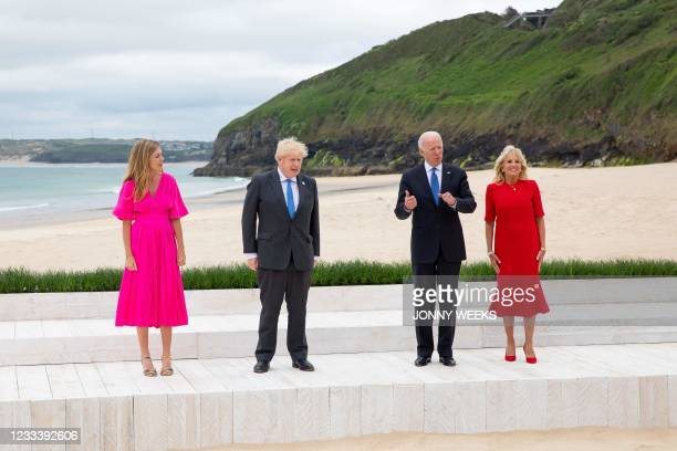 Britain's Prime Minister Boris Johnson and his wife Carrie Johnson welcome US President Joe Biden and US First Lady Jill Biden at the start of the G7...
