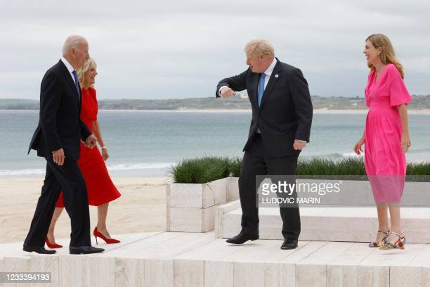 Britain's Prime Minister Boris Johnson and his wife Carrie Johnson greet US President Joe Biden and US First Lady Jill Biden as they arrive prior to...