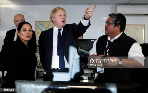Britain's Prime Minister Boris Johnson and Home Secretary, Priti Patel visit a security control room at the Port of Southampton, Britain December 2,...