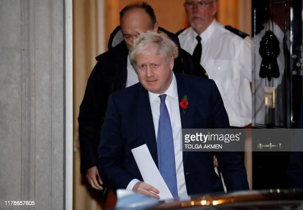 Britain's Prime Minister Boris Johnson and Number 10 special advisor Dominic Cummings leave from 10 Downing Street in central London on October 28...
