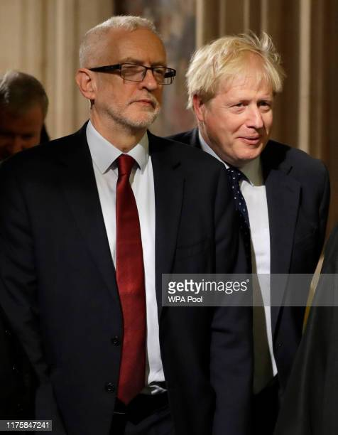 Britain's Prime Minister Boris Johnson and opposition Labour Party Leader Jeremy Corbyn left walk through the Commons Members Lobby during the State...