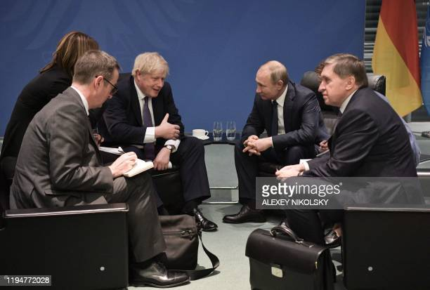 Britain's Prime Minister Boris Johnson and Russian President Vladimir Putin meet on the sidelides of a Peace summit on Libya in Berlin on January 19...