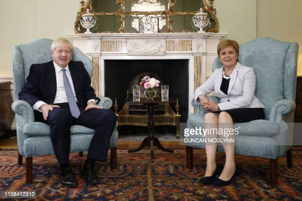 Britain's Prime Minister Boris Johnson and Scotland's First Minister Nicola Sturgeon pose for a photograph before talks at Bute House in Edinburgh...