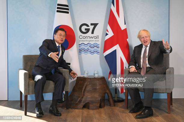 Britain's Prime Minister Boris Johnson and South Korea's President Moon Jae-in take part in a bilateral meeting at the G7 summit in Carbis bay,...