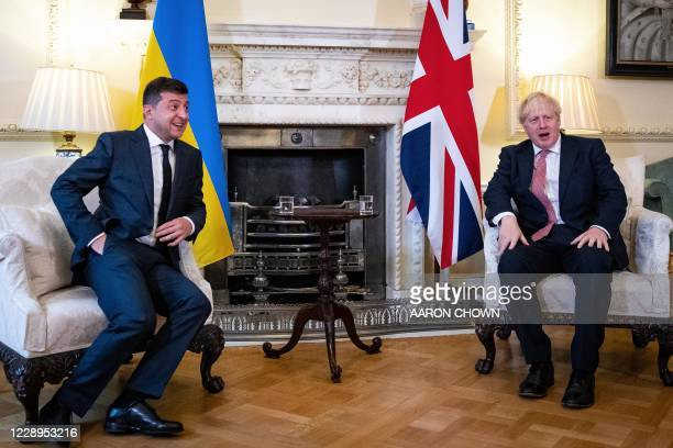 Britain's Prime Minister Boris Johnson and Ukraine's President Volodymyr Zelensky gesture during their meeting inside number 10 Downing Street, in...
