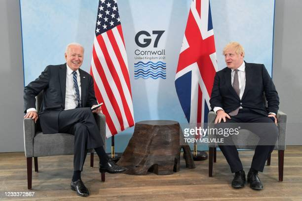 Britain's Prime Minister Boris Johnson and US President Joe Biden pose before a bilateral meeting at Carbis Bay, Cornwall on June 10 ahead of the...