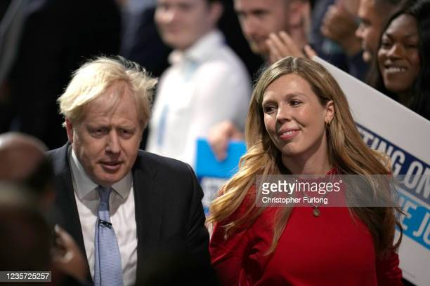 Britain's Prime Minister Boris Johnson and wife Carrie Johnson after delivering his keynote speech during the Conservative Party conference at...
