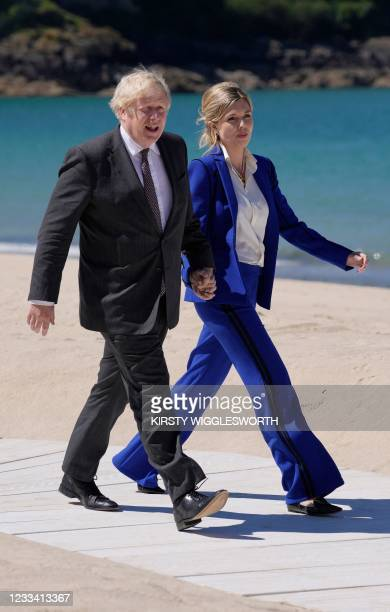 Britain's Prime Minister Boris Johnson and wife Carrie Johnson arrive to welcome leaders to the G7 summit in Carbis Bay, Cornwall on June 12, 2021.