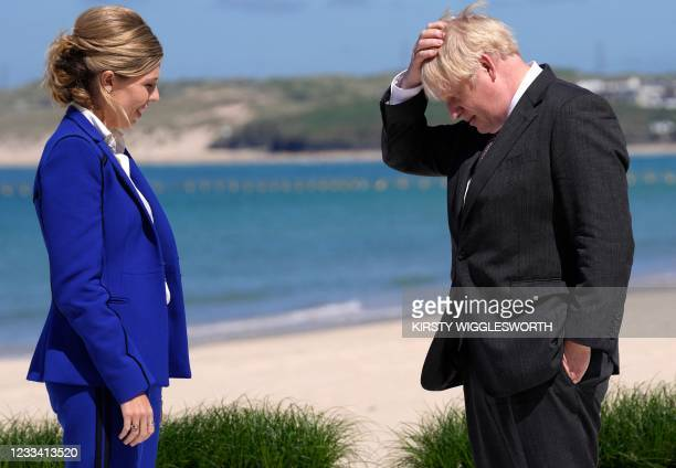Britain's Prime Minister Boris Johnson and wife Carrie Johnson prepare to welcome leaders to the G7 summit in Carbis Bay, Cornwall on June 12, 2021.