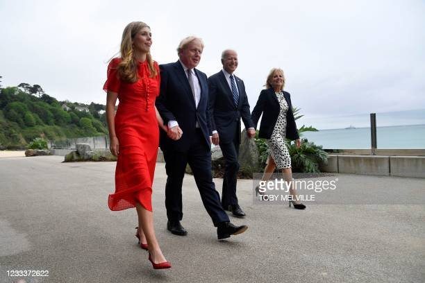 Britain's Prime Minister Boris Johnson and wife Carrie Johnson walks with US President Joe Biden and US First Lady Jill Biden prior to a bi-lateral...