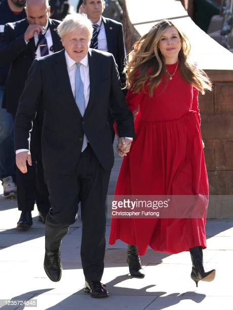Britain's Prime Minister Boris Johnson and wife Carrie Johnson, wife arrives to deliver his leader's keynote speech during the Conservative Party...