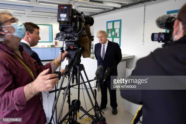 Britain's Prime Minister Boris Johnson, answers questions from the media after taking part in a science lesson at King Solomon Academy in London, on...