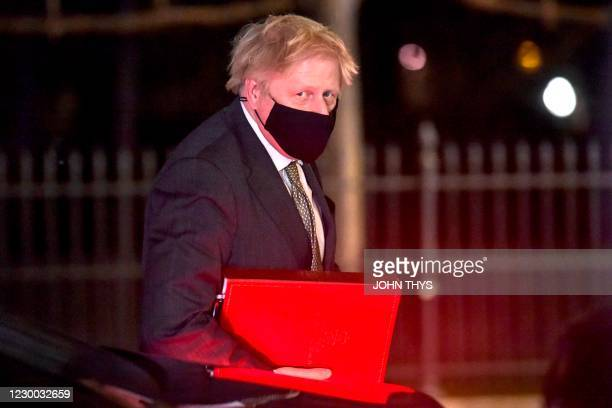Britain's Prime Minister Boris Johnson arrives at the official residence of the British ambassador to the United Kingdom in Brussels on December 9...