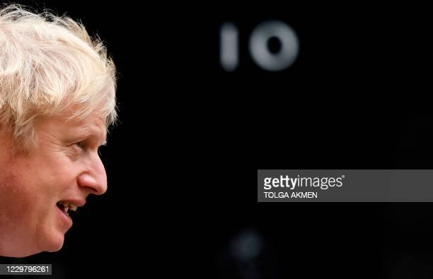 Britain's Prime Minister Boris Johnson arrives back at 10 Downing Street in central London on November 26, 2020. - Britain's government on November...