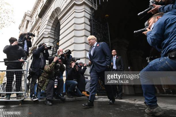 Britain's Prime Minister Boris Johnson arrives back at Downing Street in London on November 10 2020 after chairing the weekly cabinet meeting held at...