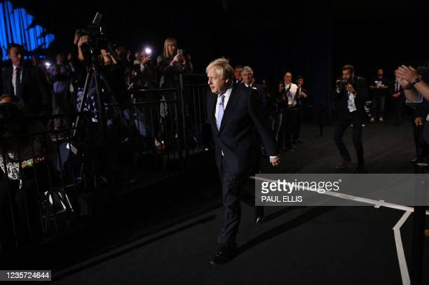 Britain's Prime Minister Boris Johnson arrives to deliver his keynote speech on the final day of the annual Conservative Party Conference at the...