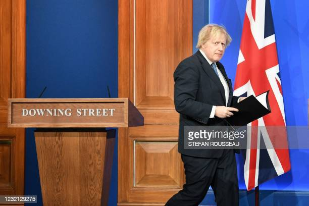 Britain's Prime Minister Boris Johnson arrives to give an update on the coronavirus Covid-19 pandemic during a virtual press conference inside the...