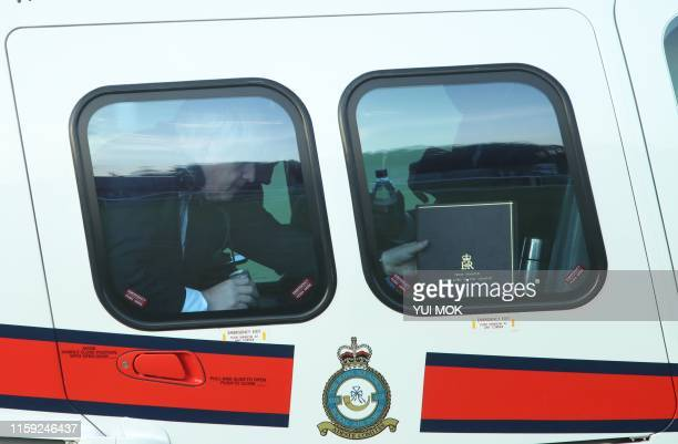 Britain's Prime Minister Boris Johnson arrives to meet emergency crews at Whaley Bridge Football Club in Derbyshire as work continued at Toddbrook...
