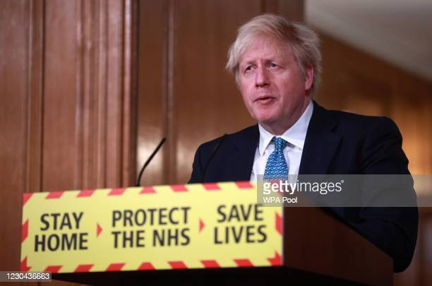 Britain's Prime Minister, Boris Johnson attends a news conference in response to the ongoing situation with the coronavirus disease pandemic, inside...