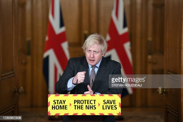 Britain's Prime Minister Boris Johnson attends a virtual press conference inside 10 Downing Street in central London on February 3 to give an update...