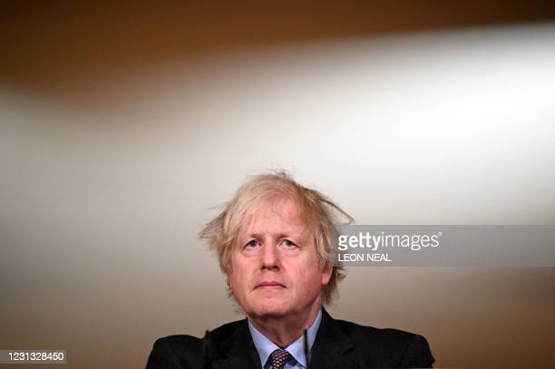 Britain's Prime Minister Boris Johnson attends a virtual press conference inside 10 Downing Street in central London on February 22 after he earlier...