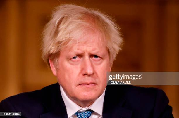 Britain's Prime Minister Boris Johnson attends a virtual press conference on the COVID-19 pandemic, inside 10 Downing Street in central London on...