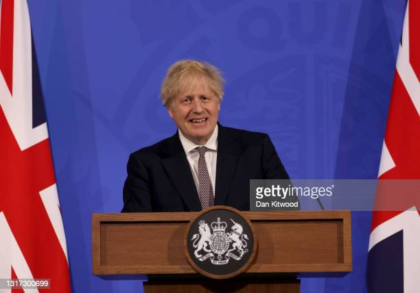 Britain's Prime Minister Boris Johnson attends a virtual press conference to announce changes to lockdown rules in England at Downing Street on May...