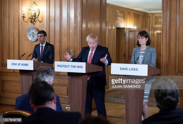 Britain's Prime Minister Boris Johnson Britain's Chancellor of the Exchequer Rishi Sunak and Deputy Chief Medical Officer Dr Jenny Harries attend a...