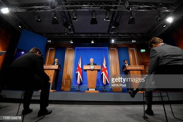 Britain's Prime Minister Boris Johnson, Britain's Chancellor of the Exchequer Rishi Sunak, and Britain's Health Secretary Sajid Javid speak during a...