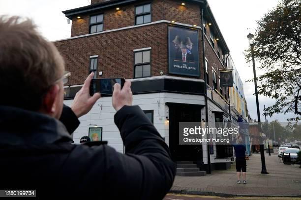 Britain's Prime Minister Boris Johnson Britain's Health Secretary Matt Hancock and Number 10 special advisor Dominic Cummings are pictured on a sign...