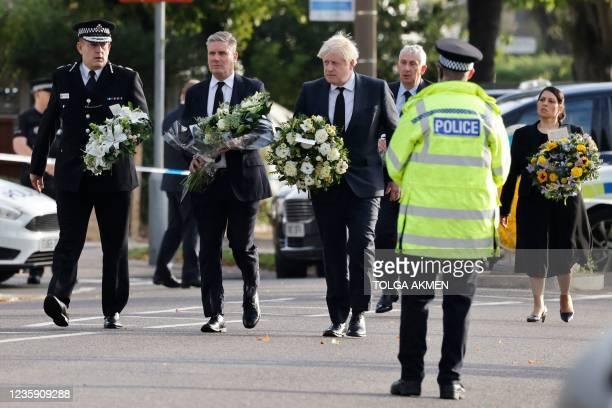 Britain's Prime Minister Boris Johnson , Britain's main opposition Labour Party leader Keir Starmer senior police officer Ben-Julian Harrington ,...