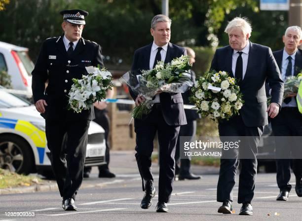 Britain's Prime Minister Boris Johnson , Britain's main opposition Labour Party leader Keir Starmer and senior police officer Ben-Julian Harrington...