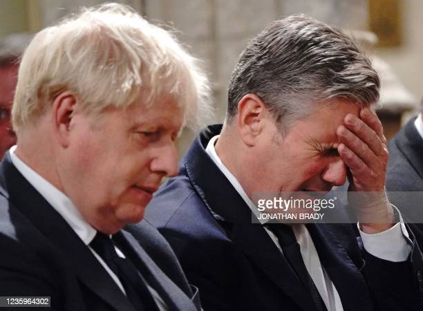 Britain's Prime Minister Boris Johnson Britain's main opposition Labour Party leader Keir Starmer attend a service of prayer and remembrance in...