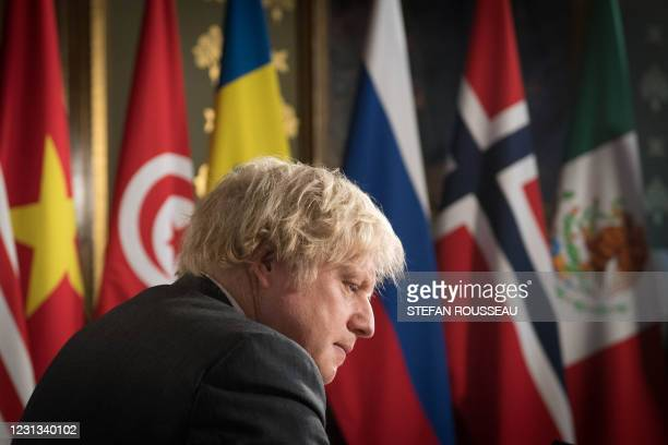 Britain's Prime Minister Boris Johnson chairs a virtual session of the UN Security Council on climate and security at the Foreign, Commonwealth and...