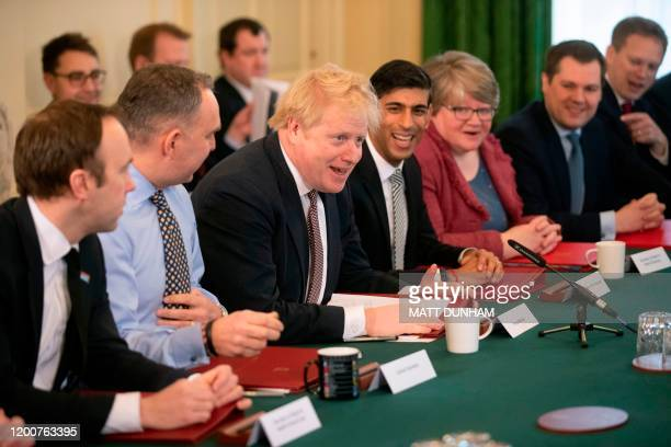 Britain's Prime Minister Boris Johnson chairs his first meeting of the cabinet the day after a reshuffle at 10 Downing Street in central London on...