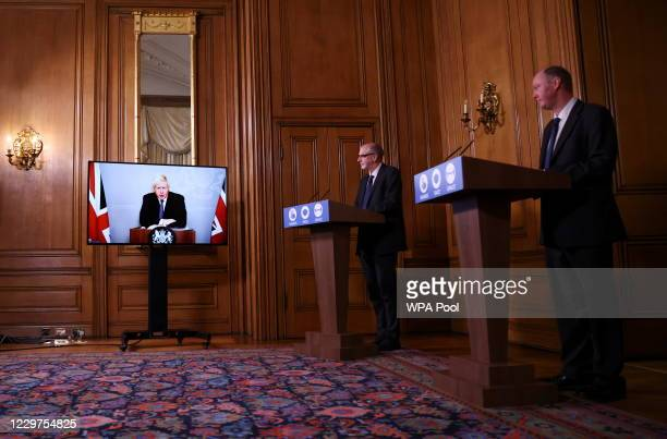 Britain's Prime Minister Boris Johnson Chief Medical Officer for England Chris Whitty and Director of the Oxford Vaccine Group Andrew Pollard attend...