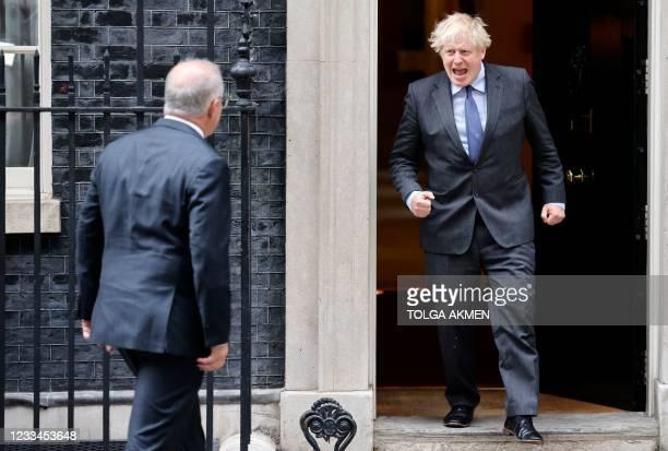 Britain's Prime Minister Boris Johnson comes out to greet Australia's Prime Minister Scott Morrison outside 10 Downing Street in London on June 14,...