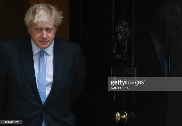 Britain's Prime Minister Boris Johnson comes out to greet Israel's Prime Minister Benjamin Netanyahu outside 10 Downing Street in central London on...