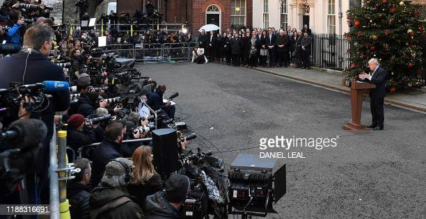 Britain's Prime Minister Boris Johnson delivers a speech outside 10 Downing Street in central London on December 13 following his Conservative...