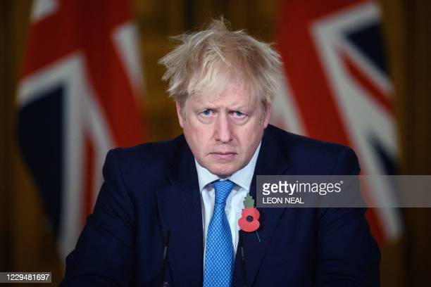 Britain's Prime Minister Boris Johnson delivers a statement on the current coronavirus statistics and testing and lockdown measures during a virtual...