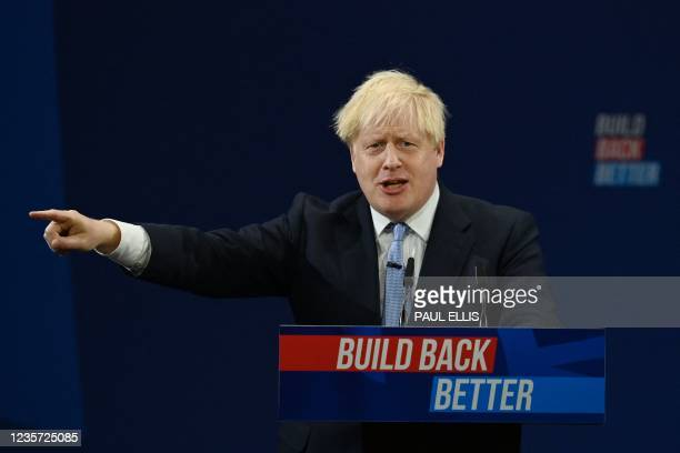 Britain's Prime Minister Boris Johnson delivers his keynote speech on the final day of the annual Conservative Party Conference at the Manchester...