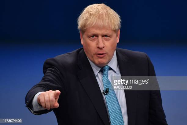 Britain's Prime Minister Boris Johnson delivers his keynote speech to delegates on the final day of the annual Conservative Party conference at the...