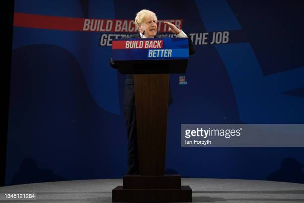 Britain's Prime Minister Boris Johnson delivers his leader's keynote speech during the Conservative Party conference at Manchester Central Convention...